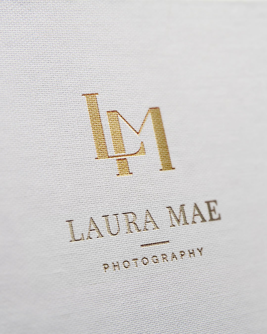 logo design gold foil laura mae photography