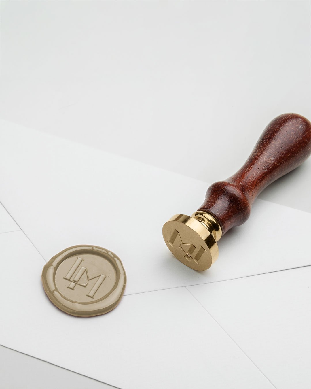 logo stamp wax seal laura mae photography design by taney creative